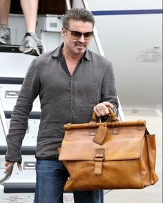 George Michael Photos Photos - George Michael arrives by private jet at Perth's private jet base ahead of his national tour, which begins in Perth tomorrow night, on February 19, 2010 in Perth, Australia. - George Michael Arrives In Australia