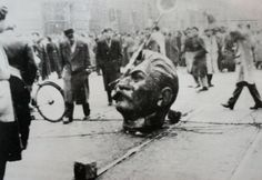 Crowds pull down a statue of stalin, budapest.