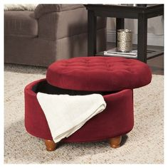 Kick up your feet and enjoy the versatility and style of this Berry Tufted Storage Ottoman. This stylish tufted ottoman has a striking profile and is upholstered in timeless velvet that perfectly complements your home's modern décor. A functional room centerpiece, this ottoman not only makes a comfy foot stool, but can also double as extra seating, a convenient storage space or a handy coffee table. Covered in beautiful velvet and padded with absorbent dacron foam for top notch s...