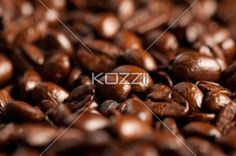 coffee beans - Coffee beans in a pile.