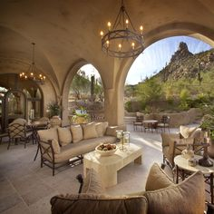 The soft colors on the groin vaulted ceiling soften the views to the outdoors. I like how the paint color blends with the color of the mountain. The furniture could use a pop of color with some pretty accent pillows and some fresh flowers. Outside Living, Outdoor Living Areas, Outdoor Rooms, Outdoor Furniture Sets, Outdoor Decor, Outdoor Seating, Patio Design, Exterior Design, Porches