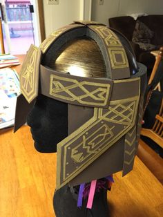 My DIY Gimli's helmet! Foam paper, metallic gold marker, and a plastic knight helmet from the dollar store. And hot glue, of course! Halloween costumes for kids. Lord of the Rings.