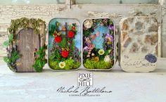 Pixie Hill: The Secret Garden altoid tin miniatures - Each tin has a fairy door and inside each one is a fairy garden