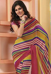 Take the fashion industry by storm in this beautiful printed saree. This dark pink, mustard and blue faux georgette saree is nicely designed with stripe print work. Saree gives you a singular and dissimilar look. Matching blouse is available. Slight color variations are possible due to differing screen and photograph resolution.