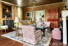 Beautifully scaled, low-slung furnishings pair deliciously with a red-lacquer secretary and an antique Nichols rug in this gathering space. - Photo: Dustin Peck / Design: John Loecke and Jason Oliver Nixon