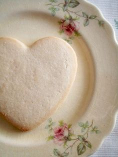 a heart shaped cookie and a beautiful plate