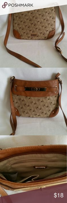 Aldo crossbody Brown cloth material with adjustable straps and 1 zipper pocket on the inside. Aldo Bags Crossbody Bags