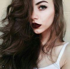 Pale make up with dark hair and dark lips