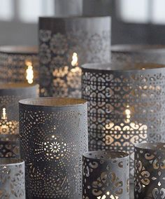 Create your own chic candle holders. Simply take pre punched paper from Michael's and wrap it around a glass cup or cylinder and drop a votive candle in it!