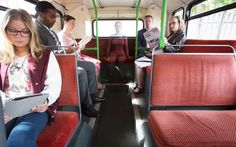 An urban camouflage model blends in on the back seat of a bus  Picture: Adam Sorenson / Barcroft Media