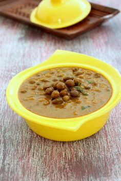Kala chana recipe with step by step photos - boiled black chickpeas are simmered in punjabi style onion-tomato gravy. It is also known as kala chana masala.