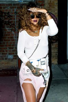 6fa05324b5 August Rihanna leaving a tattoo parlor in NYC