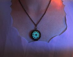 15 goal - Style A is made of copper plated Round glowing necklace # Used UV torch to charge the pendant is much faster then charge with natural lighting