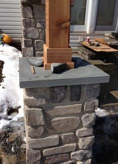 Pillar with stone veneer and cut flagstone cap.  Post is a Western Red Cedar 6 x6.  This is one of 3 pillars on an arbor that we are building.