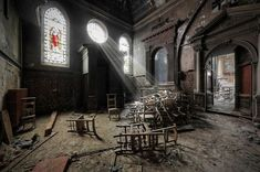 Stories abound of rays of light shining through the stained glass windows of churches and illuminating a certain individual or specific flagstone on the floor. In these images, urban explorer and urbex photographer Kiekmal creates the effect digitally with striking results.
