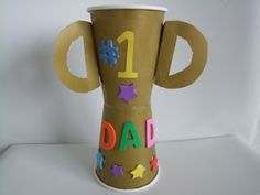 Paper cup trophy - Show Dad how much he means to you with just a little tape, glue and construction paper