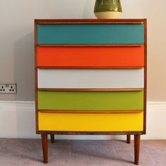 Add a splash of colour to your home with this stylish chest of drawers. Painted in vibrant and fresh mid-century colours from Kevin McCloud's Fired Earth range. This versatile storage is perfect for any room in the house. Each of the five drawers has been individually hand painted and waxed to give it a low sheen finish.