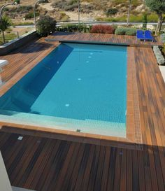 Pool Decks Fiberon Composite Decking The Exotic Wood Tones Of This Horizon Deck Shown Here In Ipe Emulate Tropical Hardwoods