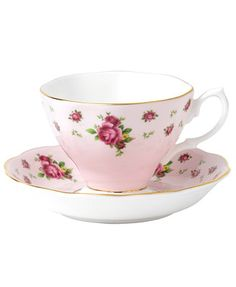 Revive a classic dinnerware pattern with the Pink Vintage cup and saucer. Lush blossoms plucked from the original Royal Albert collection flower on pink bone china with brilliant gold edges. | Bone ch