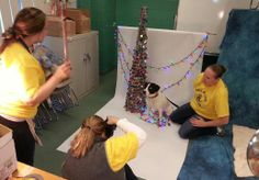 WCAC's awesome team of volunteers, Bonnie, Alicia, and Jennifer, taking holiday photos of the animals at the shelter.