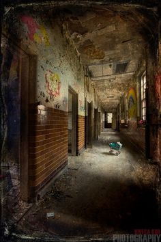 The children's ward at West Park Asylum, UK.   What up scene for a great horror movie.