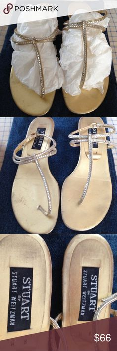 Stuart Weitzman Gold crystal sandals Sz 8 Beautiful crystal embellished Stuart Weitzman gold flat sandals (thongs) with ankle strap.  Size 8. Well worn bur not noticeably so. Some scuff marks on the side bortom, see photos. Plenty of use left.  Beautiful crystals,  dainty shoe, will add that extra something special to any outfit. These are a rare find if you are a Stuart Weitzman shoe lover. Stuart Weitzman Shoes Sandals