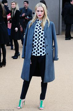 She's got style: Poppy Delevingne looked ultra trendy in her £350 Burberry polka dot blouse when she attended the  Burberry Prorsum autumn/w...