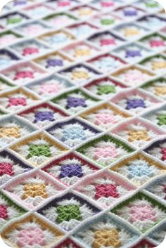 OMGosh!  This lady used 432 TINY grannies to make this luscious afghan!  I wonder if I could have that much patience?