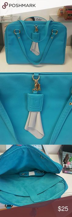 Nwt turquoise  computer bag Has a very light mark on the back hardly notable,  beautiful color gold hardware tyla rae Bags Laptop Bags