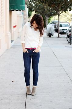 Bright pink belt with dark jeans, simple white shirt