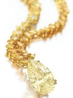 A colored diamond pendant necklace