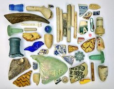 Pieces of ceramic and glass that Atherton has found in the Thames, interspersed with more recent trash.