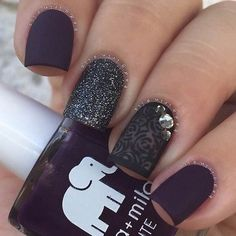Hearty Black and white nail work. This simple yet amazing nail art is another option, that you can go for. The black glittery hearts on the white base makes the best elegant choice for the classy people out there.