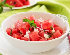This refreshing salad includes two of summer's best produce options – watermelon and tomatoes! Served with dressing, fresh herbs, sliced almonds and feta cheese, the unlikely combination is full of flavor and low in calories. Summertime Salads, Summer Salads, Herb Salad, Watermelon Salad, Sliced Almonds, Strawberries And Cream, Vegetable Side Dishes, Easy Snacks, Light Recipes