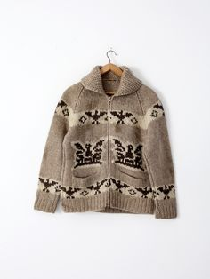 A vintage hand-knit cowichan sweater. The thick wool sweater features a thunderbird eagle pattern in natural wool tones and a zipper closure. - cowichan sweater - zip up closure cardigan - thick wool Baby Sweater Patterns, Hand Knitted Sweaters, Baby Knitting Patterns, Wool Sweaters, Sweater Shop, Sweater Coats, Sweater Jacket, Cowichan Sweater, Sweater Making