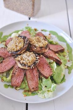 Fresh iceberg salad topped with medium grilled lamb fillet