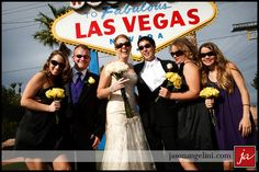 wedding party with the Welcome to Fabulous Las Vegas sign