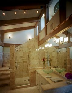 Sophisticated, elegant and luxurious craftsman inspired bathroom with tongue and groove ceiling, and warm natural travertine stone tile staircase. | By Craftsman Homes of Austin