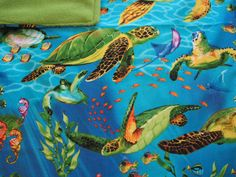 """UNDER THE SEA Catnip Blanket UNDER THE SEA Catnip Blanket  Amazing, Vibrant Cotton Fabric .  Sea Life Abounds The Reverse Side is Verdant Sea Green Each Blanket has a Generous Hand Full of 100% Organic Catnip Grown in Montana ONLY THE BEST !!!!  18″ x 24 """" in size"""