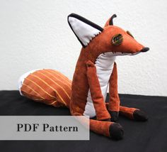 DIY fox plush! Now you can make your very own cuddly fox friend. When finished the plush will sit around 28 cm/ 11 inches tall You will need: For the basic plush: Orange, black, white fabric Sewing thread to match your fabrics Fabric scissors Black yarn and needle Buttons for eyes