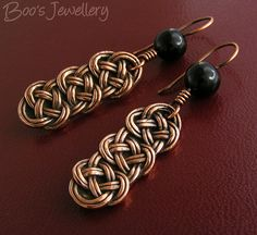 Celtic-style knot earrings initially made in leather from which I took a mold and made copies in solid copper using copper clay.  There is a glossy black onyx bead on each earwire.