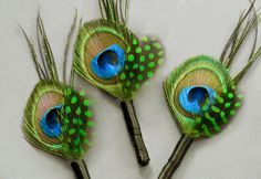 Don't forget the guys! We love the layered feather effect of these Etsy boutonnieres.