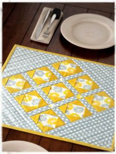 Love this #quilted table topper made with #DSQuilt collection fabric!