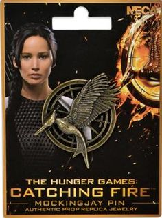 The Hunger Games: Catching Fire Mockingjay Pin available at Sprint Halloween store on the 30th