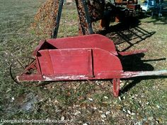 Vintage red wheelbarrow -- fill with hay or pumpkins. Great fall decorator item!