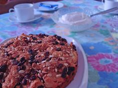 German Coffee Cake filled with almonds and raisins and topped with brown sugar and cinnamon. http://www.quick-german-recipes.com/german-coffee-cake-recipe.html