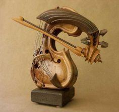 Violin sculpture by Phillipe Guillerm