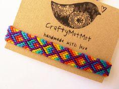 Arco iris pulsera hecha a mano tejida pulsera Art por CraftyMotMot