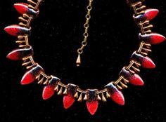 vintage matisse renoir deep red enamel on copper necklace. $224.50, via Etsy.