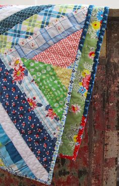 string quilt -the scrappy binding here is fun. I like the white strip in the middle that ties it all together.